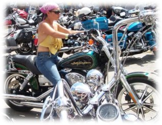 biker chick cruising through sturgis